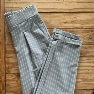 Cropped grey and white pinstripe trousers